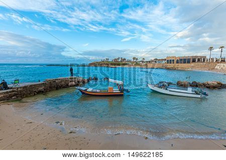 Haifa, Israel - February 18, 2013: Fishermen And Boats Near Caesarea Maritima