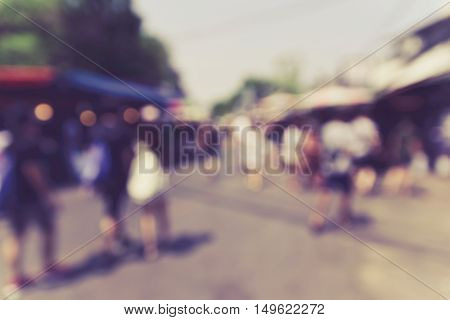 Blurred background : people shopping at market fair in sunny day blur background with bokeh