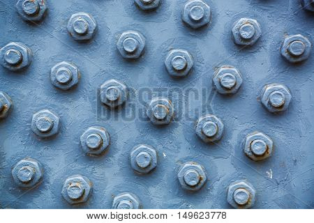 Bolts and nuts on the blue wall
