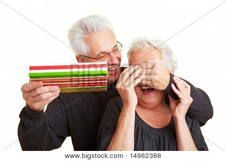 Man Covering Eyes Of His Wife