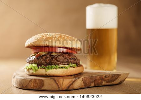 fresh homemade burger with beer on olive board, shallow focus