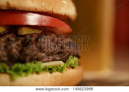 homemade hamburger with beer on background, shallow focus