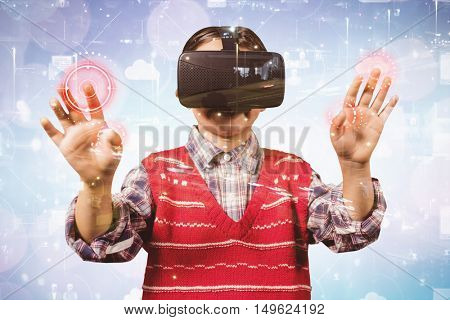 young boy in red jumper with virtual reality headset against image of the city