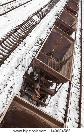 Empty freight wagons on the railroad in winter