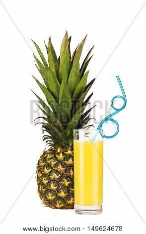 A whole pineapple fruit and a glass of pineapple juice with drinking straw isolated on white background
