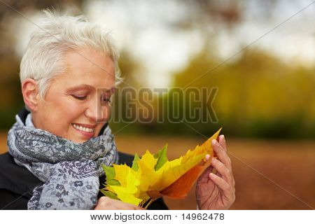 Woman Looking At Maple Leaves