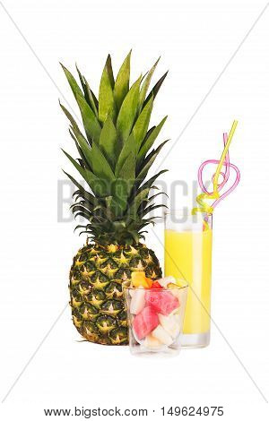 Pineapple a glass of pineapple juice and pieces of fruit isolated on white