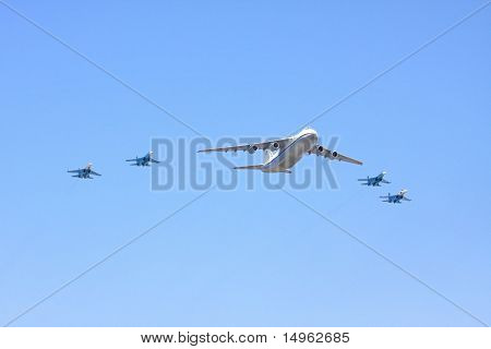 The Transport Plane Accompanied By Warplanes On Parade