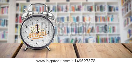 alarm clock over white background against teacher giving lesson to her students