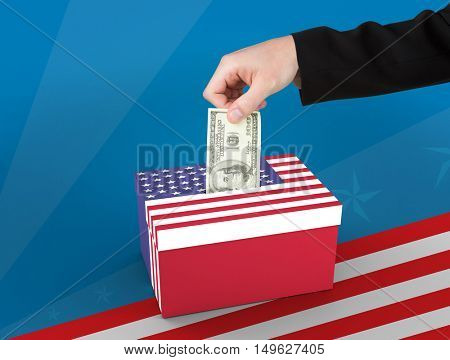 Hand holding hundred dollar bill against cardboard box with american flag print