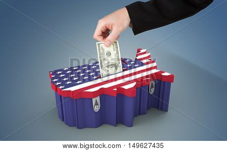 Hand holding hundred dollar bill against printed carboard box