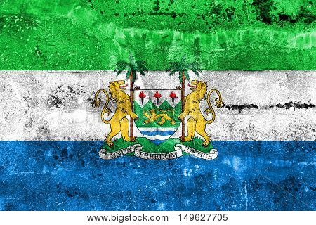 Flag Of Sierra Leone With Coat Of Arms, Painted On Dirty Wall
