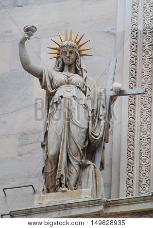 Milan, Italy - October 14, 2014. Statue, depicting woman figure, adorning the Duomo cathedral in Milan.