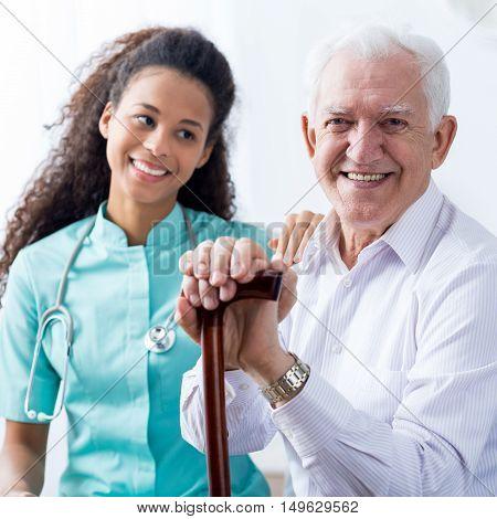 Young Pretty Nurse And Senior Man