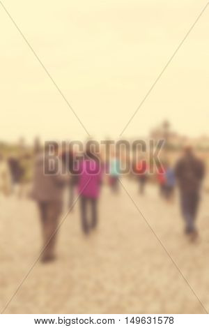 High blurred image of crowd people on street unrecognizable faces.