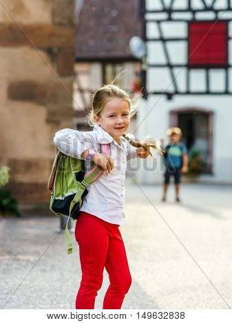 Cute Little Girl On The Way To School.