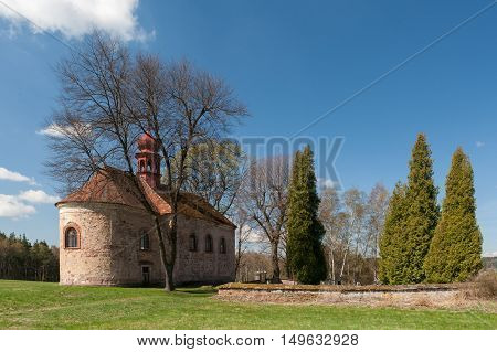 Old church and cemetery in the village in Czech Republic