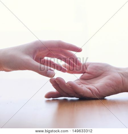 Close up of two hands isolated on white background