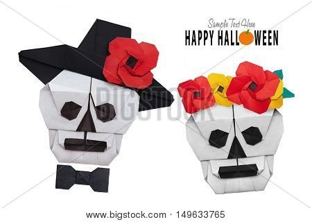 Origami paper halloween skull in a hat isolated on a white backgroumnd