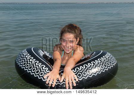Woman On The Sea Sitting On A Buoy Having Fun