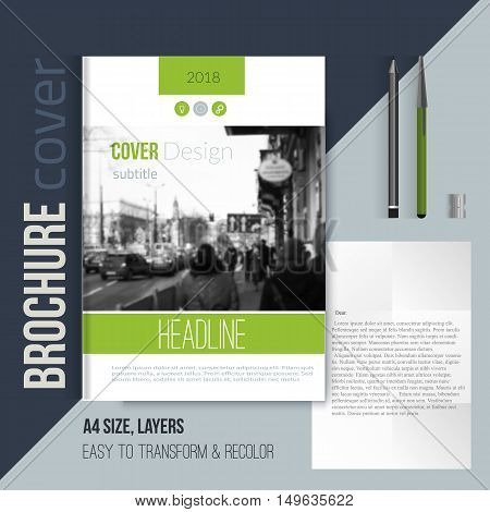 Green brochure cover template with blured city landscape letter and pen. Corporate identity. Business design, flyer, professional.