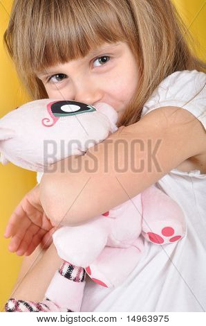 Child With A Toy Cat