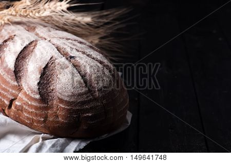 Wheat And Bread On A Wooden Table