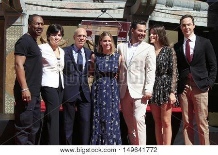 LOS ANGELES - SEP 29:  Eddie Murphy, Jeffrey Katzenberg, Stacey Snider, Jim Parsons at the Katzenberg Hand And Footprint Ceremony at the Chinese Theater IMAX on September 29, 2016 in Los Angeles, CA