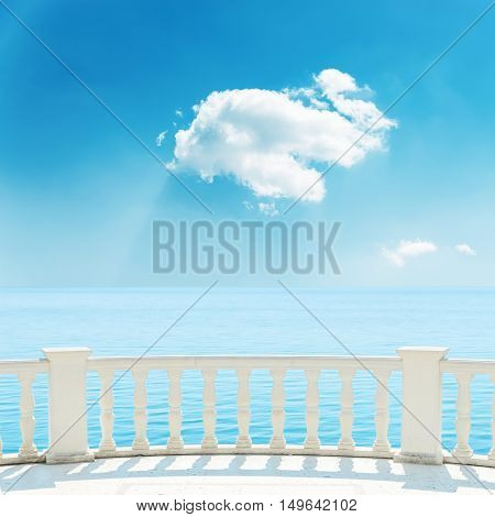 balcony near sea and white cloud in blue sky over it