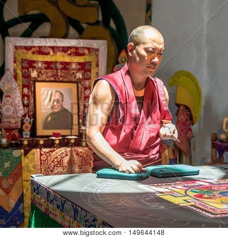 Tibetan Monks Making A Mandala