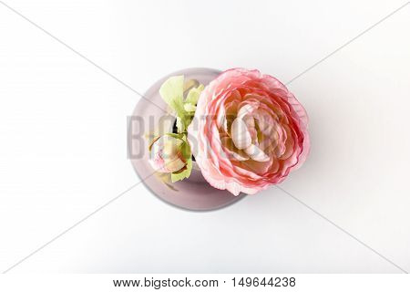 handmade glass vase with pink roses in studio