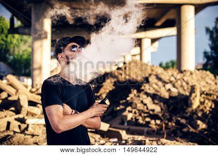 Vaper With Beard In Sunglasses Vaping Outdoor