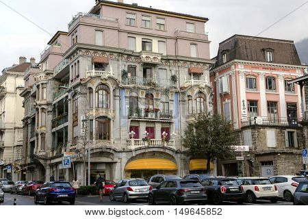 SWITZERLAND, MONTREUX, DECEMBER, 29, 2015 - Beautiful architecture of old buildings with city traffic on the streets in the center of Montreux, Switzerland