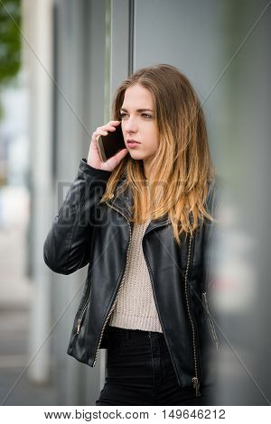 Teenager on phone having difficult talk - outdoor in street