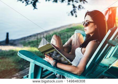 Girl Reading Book Outdoor On The Beach