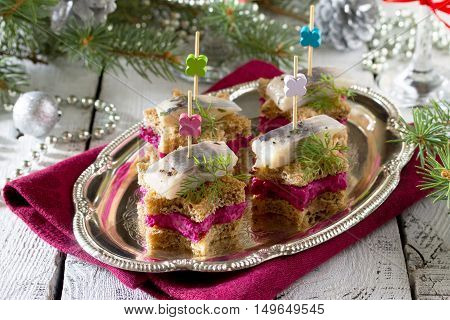 Canapes In The Form Of A Star With Pickled Herring, Beetroot And Dill Dip. Breakfast Table At Christ