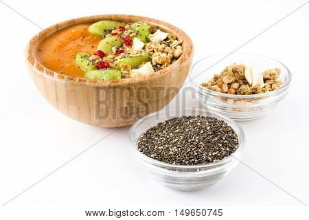 Healthy smoothie with fruit, cereals and chia seeds in a bowl isolated on white background