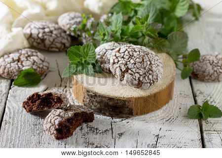 Chocolate-mint Cookies And Powdered Sugar On A Wooden Background.