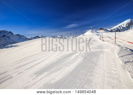 View To Ski Slopes With The Corduroy Pattern And Ski Chairlifts On The Top Of Fellhorn Ski Resort, B