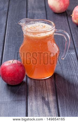 fresh apple juice in the pitcher table close up