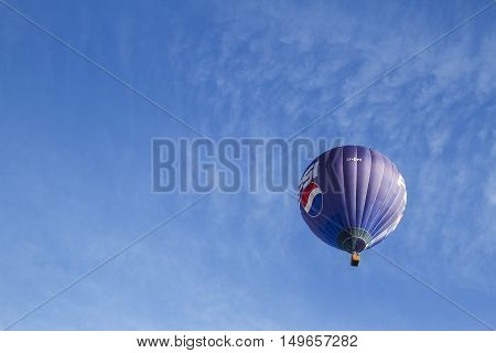 VILNIUS, LITHUANIA - JULY 16 2016: Hot air balloon in the air over Vilnius city center. On July 16, 2016 in Vilnius, Lithuania
