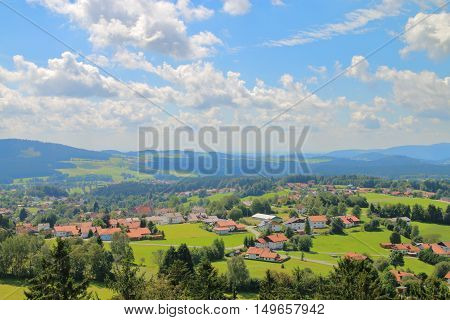 The picture was taken in Germany near the town of Grafenau. In the picture visible cloud landscape Bavarian valleys and hills covered with forests.