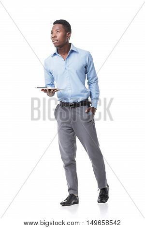 Handsome African American businessman with digital tablet on white background