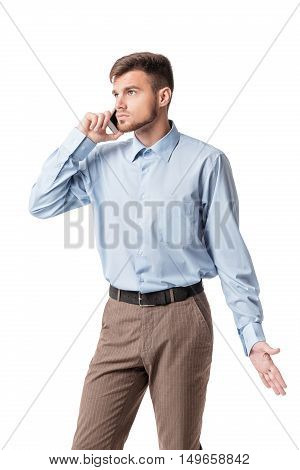Portrait of  indignant businessman talking on the phone isolated on a white background