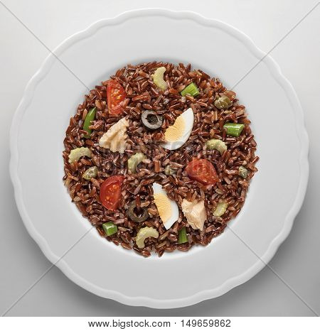 Top view of Red Rice of the Camargue salad with tuna egg and vegetables