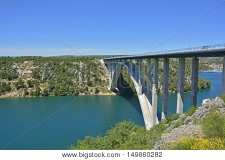 An inlet of the Adriatic Sea near Skradin in Sibenik-Knin County in Croatia. The E65 motorway can be seen passing over the inlet.