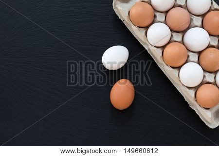 White And Brown Chicken Eggs On Black Background