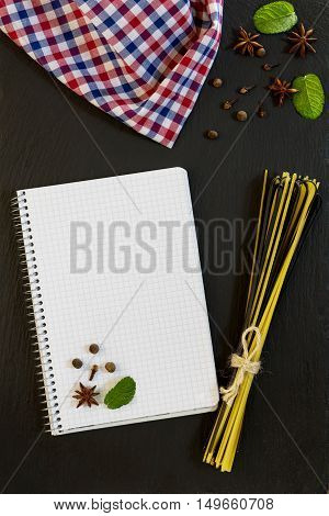 Blank Cookbook With Conventional And Black Uncooked Italian Pasta