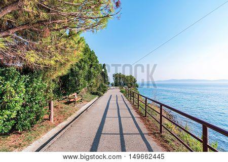 Scenic walking path by the sea in Zadar