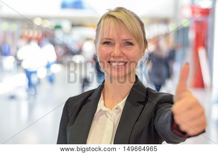 Smiling Motivated Woman Giving A Thumbs Up